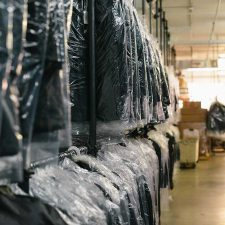 Clothes hanging in dry cleaning warehouse