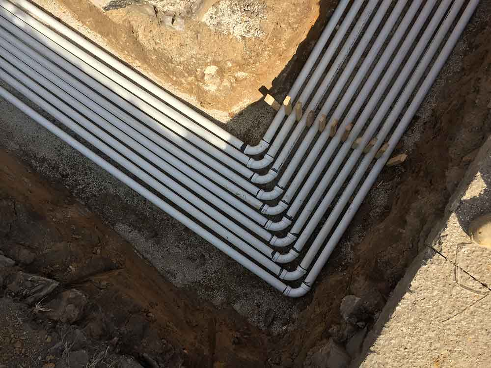 Conduit tubes buried underground for a Soil Vapor Extraction (SVE) System