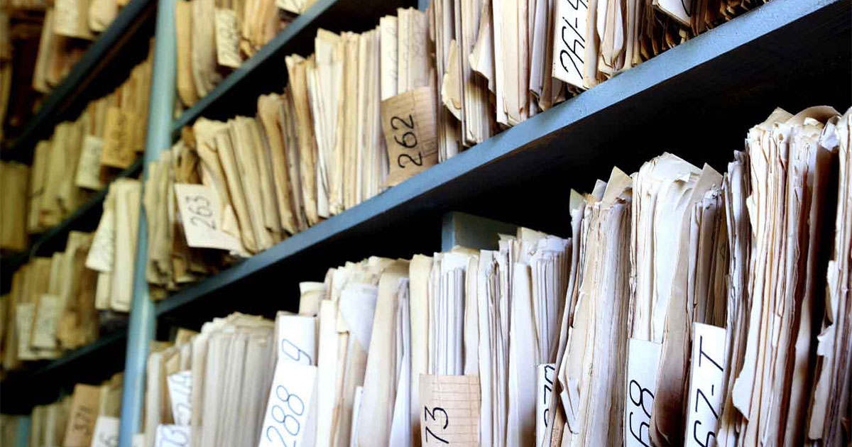 old files on shelves found during insurance archeology that can be used to pay to address environmental contamination