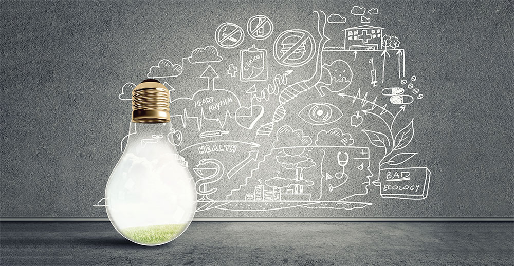 Environmental lightbulb in front of chalkboard with remediation and health-related sketches