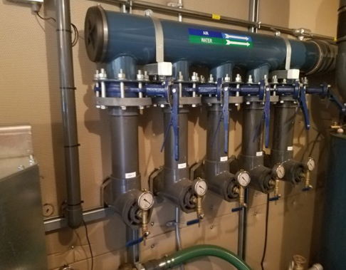 Series of pipes and gauges that make up extraction wells for the remedial technology of a soil vapor extraction system