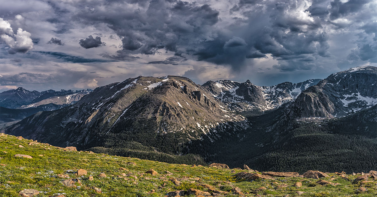 Picture of Rocky Mountains with dark clouds in the sky