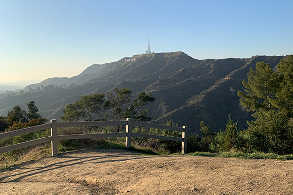 Picture of Mount Hollywood with Hollywood sign in distance and split rail fence in foreground