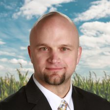 Headshot of Brian Kappen in front of sunlit cornfield