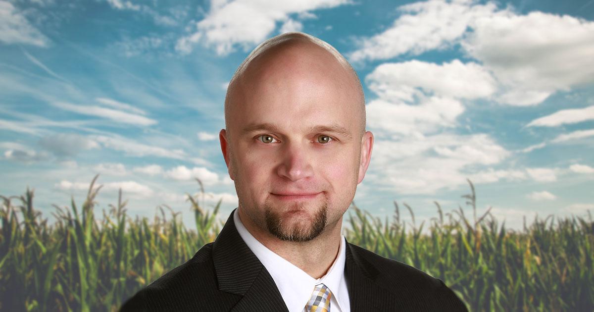 Headshot of Brian Kappen in front of sunlit cornfield