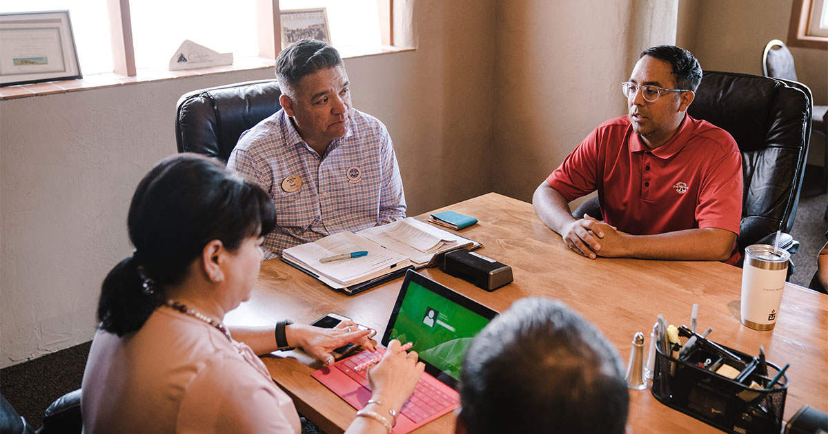 Drycleaner sitting at table negotiating real estate transaction of property and business