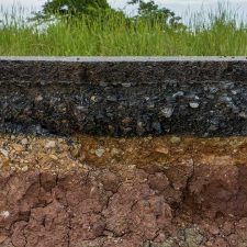 Cross-section look at the subsurface where PCE contamination can potentially transport through soil and into groundwater a great distance away from a drycleaning operation