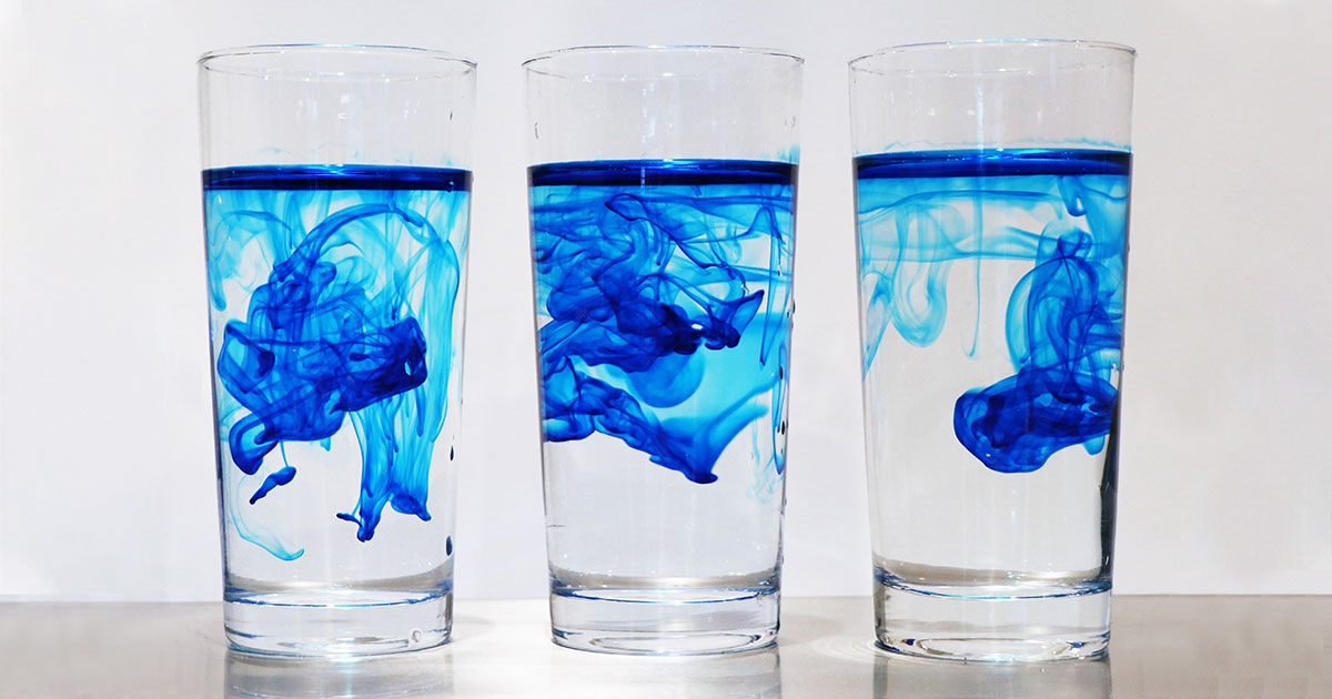 lue ink being diluted by water in three glasses similar to how perc is diluted in groundwater
